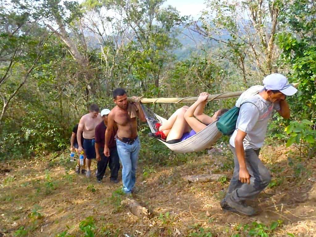 Our patient slowly making her way back to civilisation. Canyoning In El Salvador