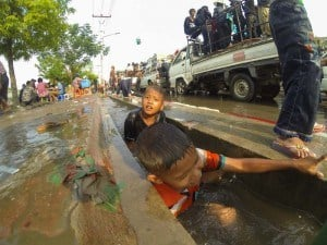 Kids playing in the drain.