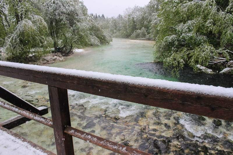 Snow in Lake Bohinj. Train travel In Europe