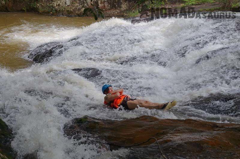 Lesh enjoying the natural water slide. Canyoning in Dalat.