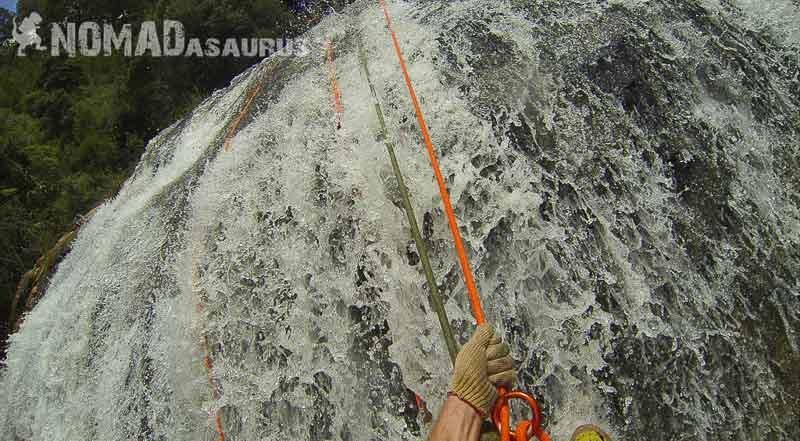 Abseiling down the waterfall. Canyoning in Dalat.