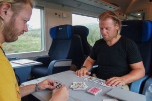 Ginski and Nick playing cards on the train from Bari to Naples. Train travel in Europe.