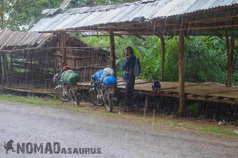 Jazza waiting for the rain to die down. Laos motorcycle adventure