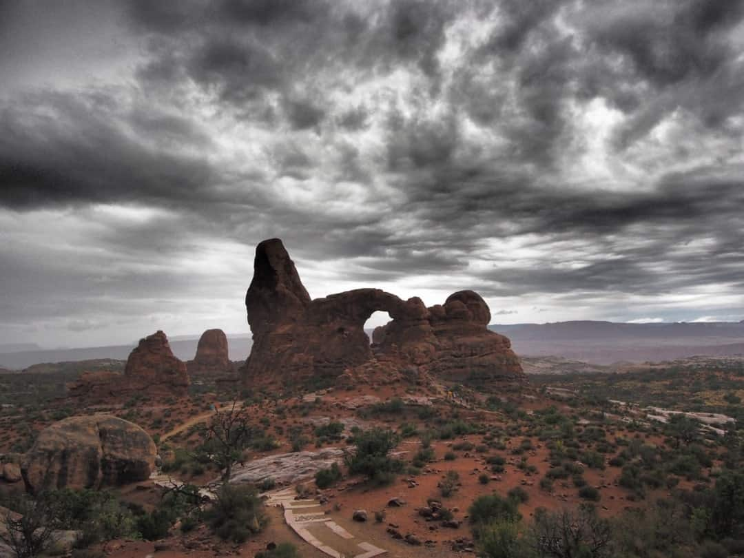 Storm Clouds Brew Over The Formations At Arches National Park Utah