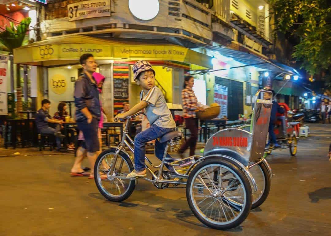 Boy Riding Through Markets