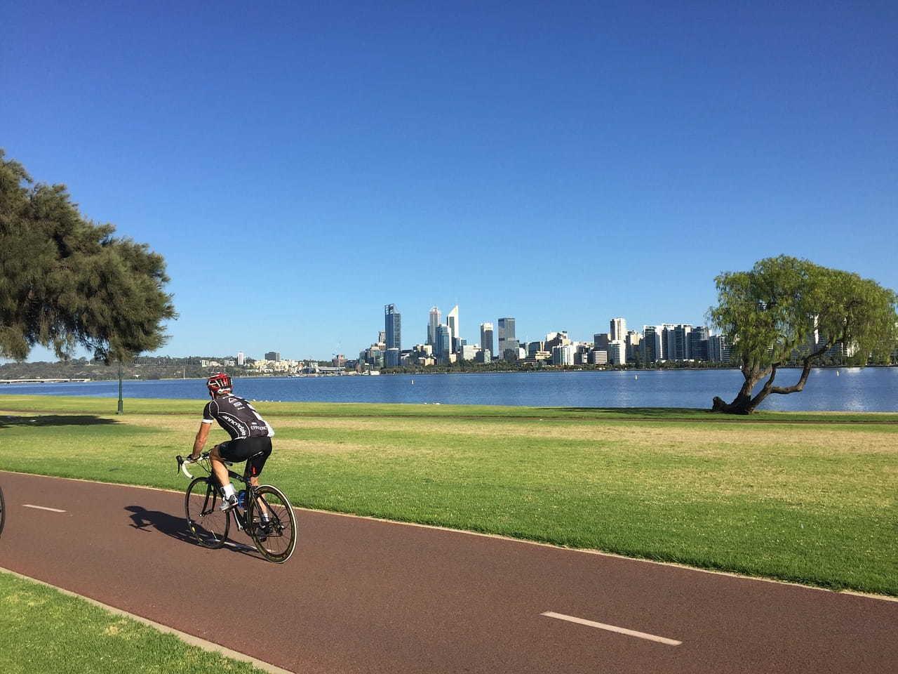 Cyclist Biking Along Foreshore