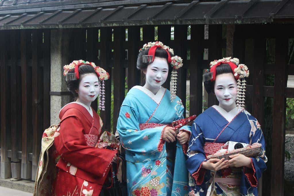 Three Geisha Standing Together In Japan
