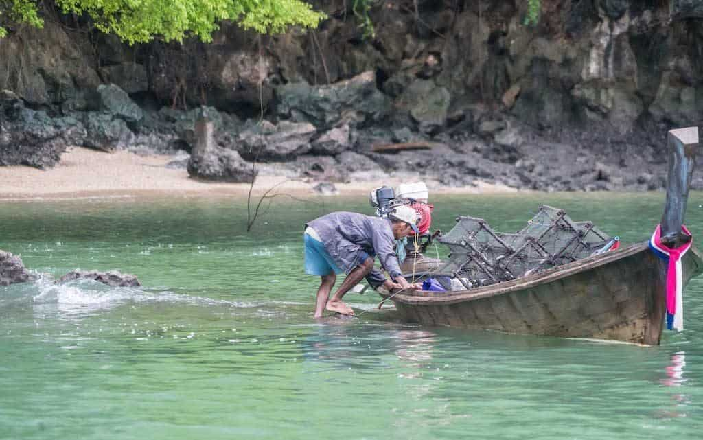 A Local Fisherman And His Boat