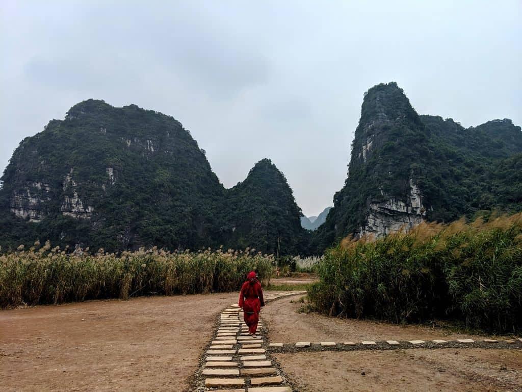 Huge limestone cliffs dominate the landscape in Ninh Binh
