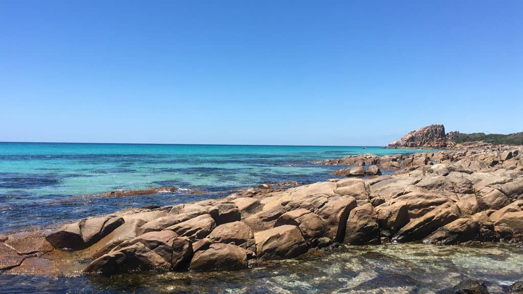 Clear Blue Waters On A Clear Day With Rocks