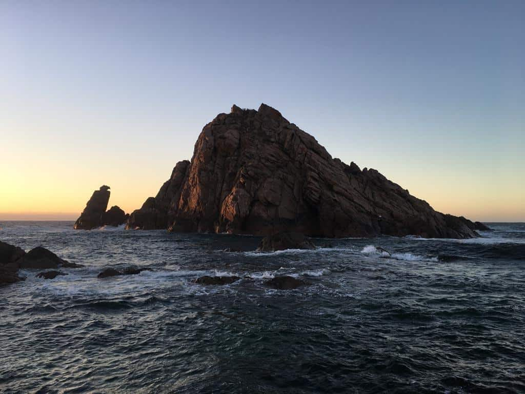 Huge Rock Out In The Ocean At Sunset