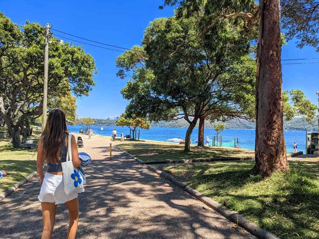 Girl Walking On Shark Beach